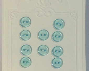 10 Buttons light blue in resin. 10mm 2 holes.