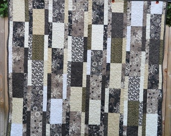 Black, Beige, and Creme Lap quilt