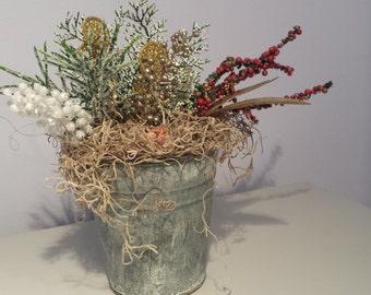 Winter themed faux flower arrangement