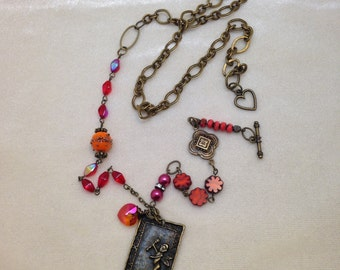 Necklace, cupid, assemblage pendant necklace