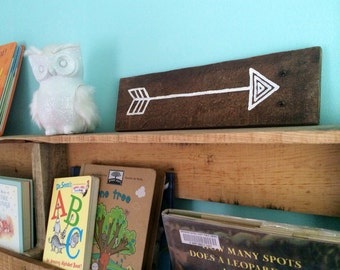 Painted arrow on reclaimed wood