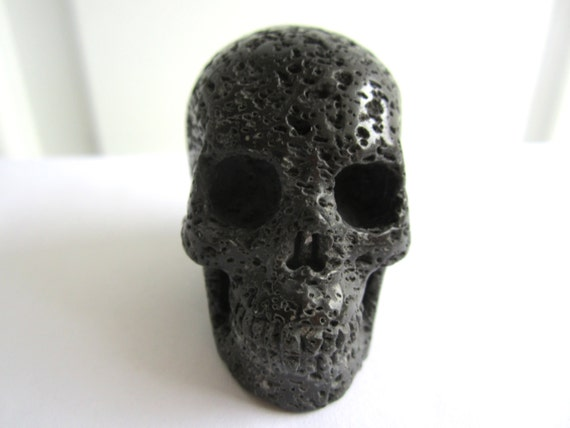 Black lava stone carved crystal skull