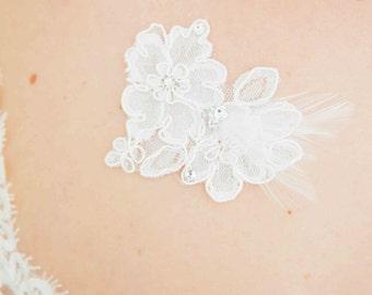 Skin of bridal jewellery, lace rhinestones and feathers - wedding jewelry
