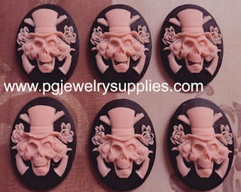 25mm x18mm oval resin guns n roses skull cameos pink on black 6 pieces