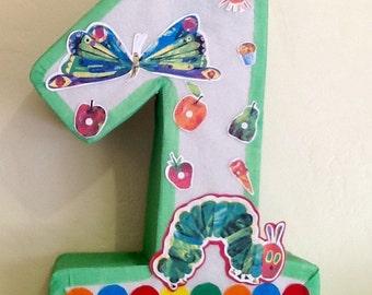 Hungry caterpillar pinata. Hungry caterpillar birthday Party. Hungry caterpillar party decoration.