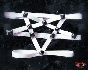 White pentagram garter with black studs
