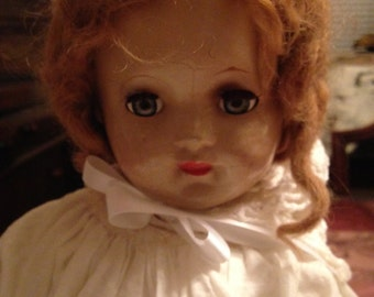 Beautiful composite mama doll with lovely old white dress