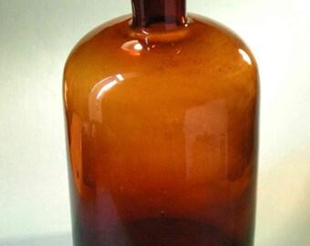"Big, brown, glass ""pharmacy"" bottle"
