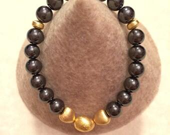 Genuine Hematite stretch bracelet with gold plated details