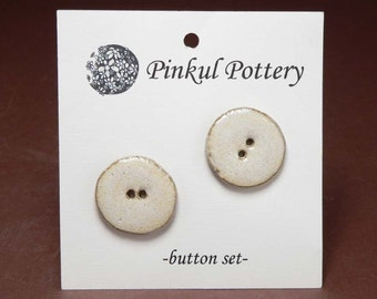 Medium sized cream buttons; perfect for favorite sweater!