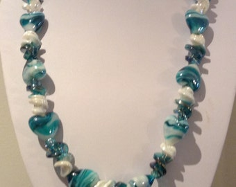 Necklace. 60cm Features High Quality Lampwork Glass heart and curly twisted beads. Teal