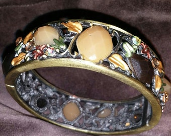 Antiqued Copper and Gold Tone Filigree Hinged Bracelet with Floral Motif and Rhinestone Accents