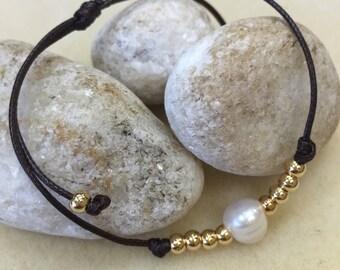 Pearl on a leather bracelet