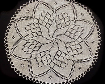 Beige handmade knitted oval doily