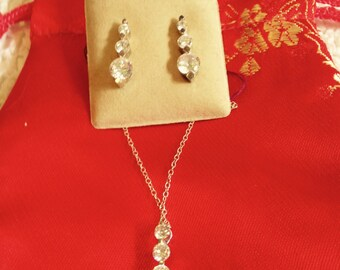 Sterling Silver And Cubic Zirconia Necklace And Earrings