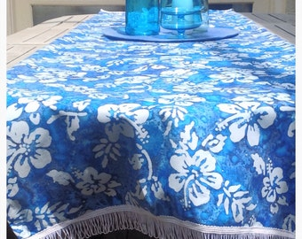 Pool party! Fun, tropical print table runner in gorgeous shades of blue and turquoise trimmed with white fringe.