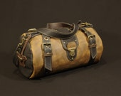"travel bag, ""duffel"" .in brown and black leather ( vegetal tanning). man"