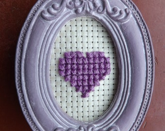 Little cross stitch hearts in oval frames.