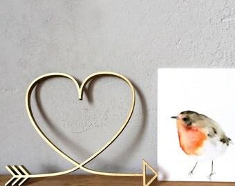 curved arrow - heart - wood motive