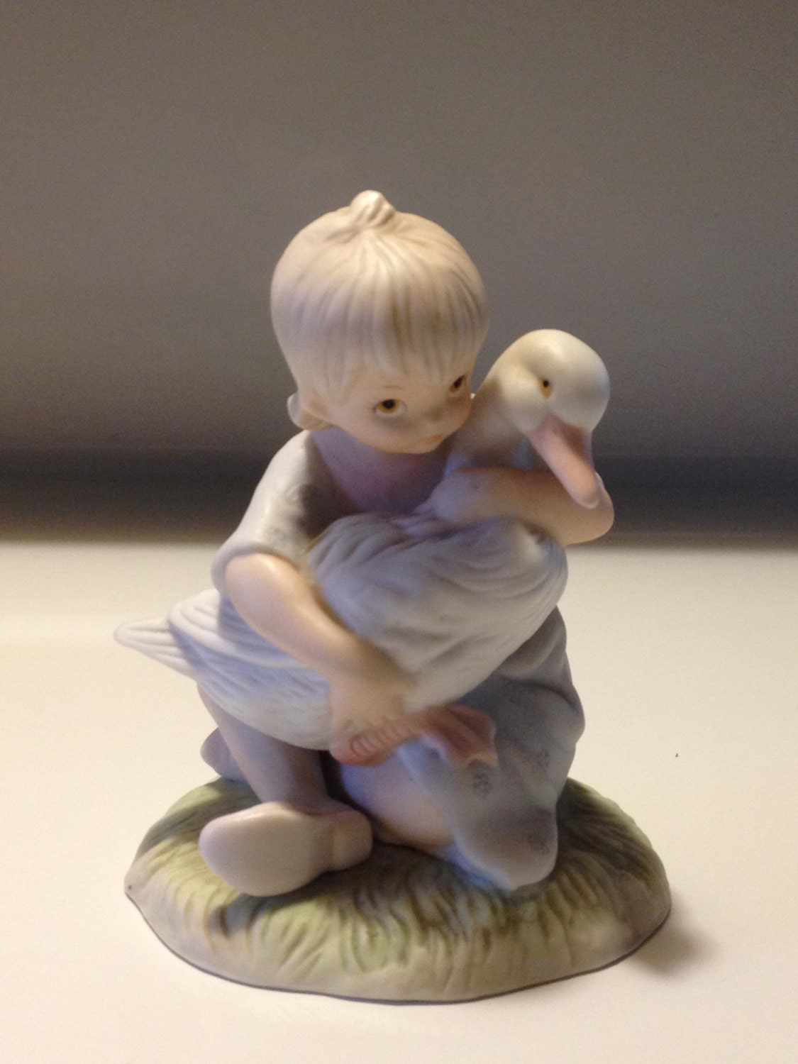 vintage lefton figurine girl holding goose by