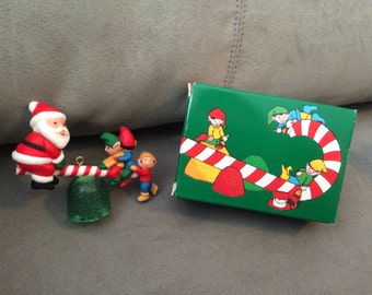 Vintage Avon Santa's See-Saw Christmas Tree ornament Santa & Elves New in Box Collectible