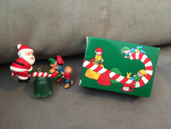 Vintage Avon Santa's See-Saw Christmas Tree Ornament Santa