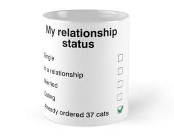 My relationship status'.  Quality printed mug in ceramic or plastic/polymer