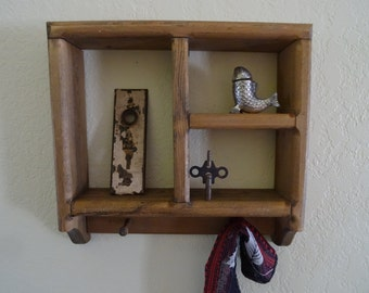 Rustic all wood shelf with pegs for hanging