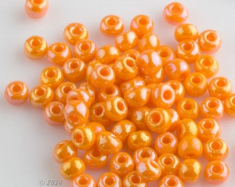 Vintage orange sorbet luster seed beads. 10 gram bag. b17-249(e)
