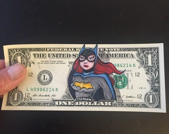 Batgirl from Batman the animated series painted on a dollar.
