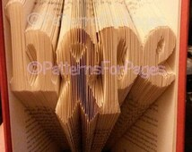 Book folding pattern for HOPE with a cancer awareness ribbon