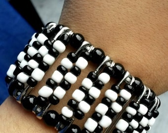Black and white bracelet with safety pins and beads