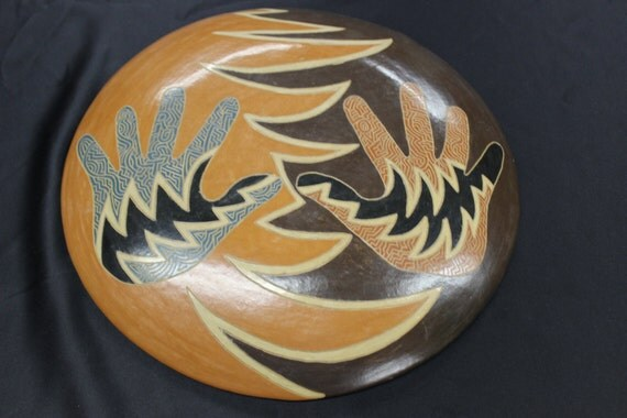 """Trust and Love """" Original design, handcrafted , wood fired, burnished, sgraffito carved Plate. Nicaragua Diversity project13 1/4 dia."""