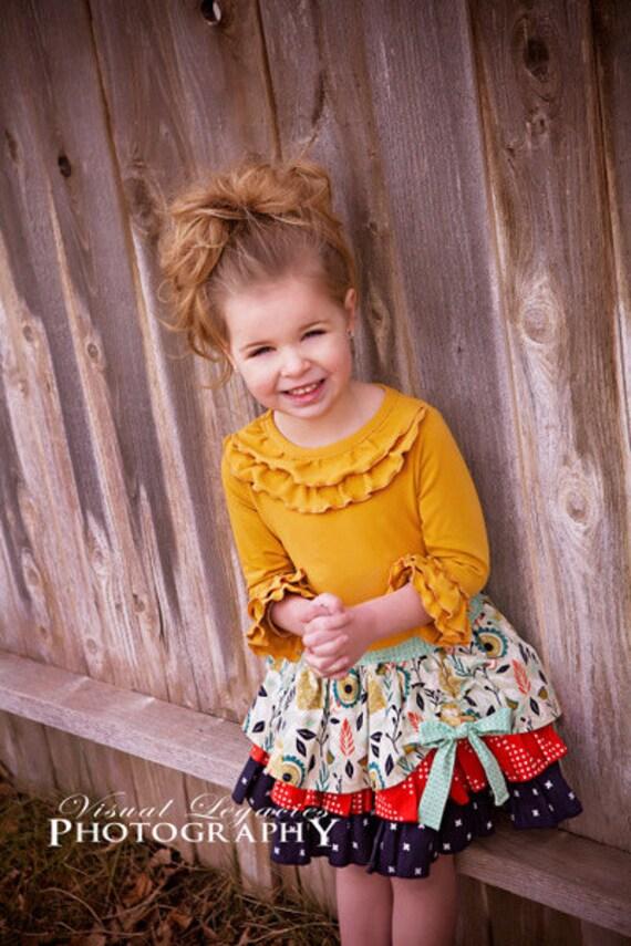 Pepper's Peekaboo Ruffle Skirt. PDF sewing pattern for toddler girl sizes 2t - 12.