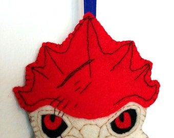 Urdnot Wrex from the Mass Effect games. A hand sewn felt ornament in 2-D.