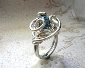 Uniquely Sculptural Sterling Silver Ring with Multifaceted Iridescent Crystal Bead