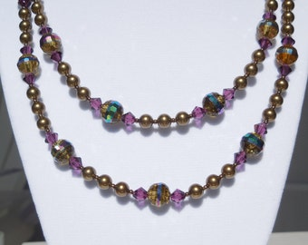 Amber glass with Swarovski antique brass pearls and amethyst crystals