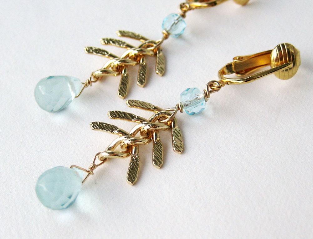 Gold fish bone chain clip on earrings faceted light blue for Fish bone earrings