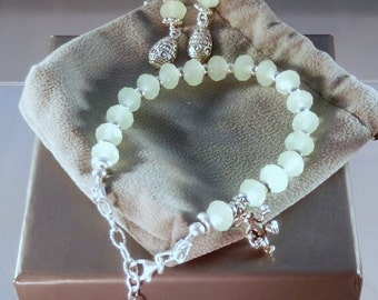 Jade Crystal bracelet with genuine silver bunny and Easter egg charms, matching earrings