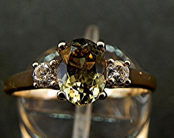 AAAA Olive Green Tourmaline   8x6mm  1.17 Carats   with .14 cts of Diamonds 14K Yellow gold three stone ring 1105
