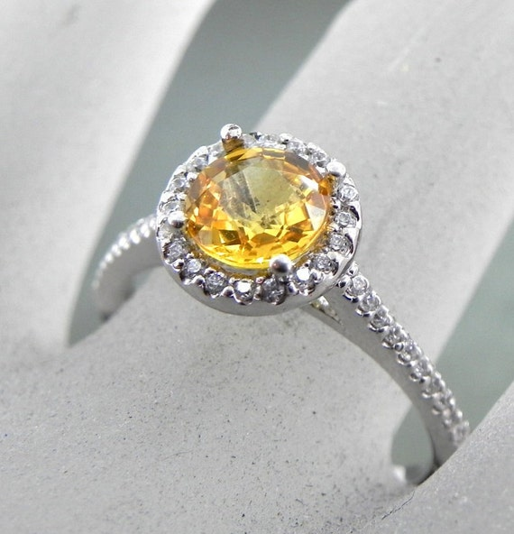 AAA Yellow Sapphire   6.75mm Round 1.47 Carats   in 14K white gold Halo ring with .35 carats of diamonds 0972