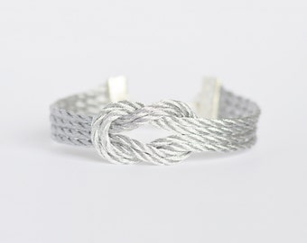 Metallic silver forever knot nautical rope bracelet with silver anchor charm