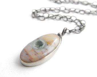 Small ocean jasper necklace, soft colors, single dark green orb, simple bezel-set metalwork sterling silver necklace.