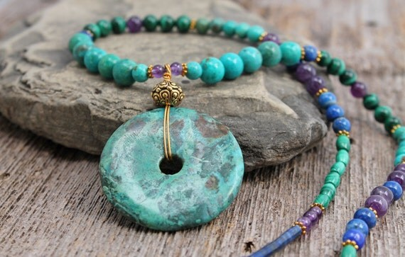 Necklace with turquoise donut and lapis lazuli, malachite and amethyst beads