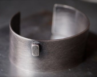 Wide off-centered fine silver nugget and sterling silver cuff bracelet