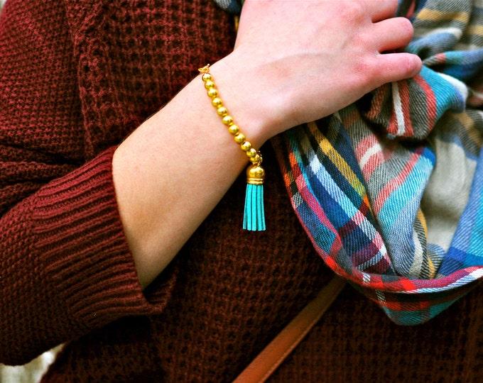 Gold Beaded Tassel Bracelet.