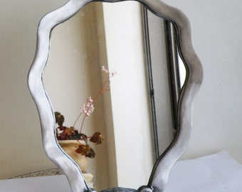 A table mirror, frame made of cast aluminum