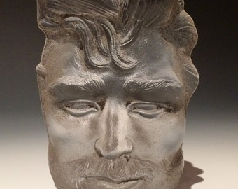 Cast glass sculpture, face of a man, sand cast portrait art mask