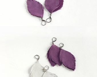 Suede leather feather earrings in violet and in light grey. Set of two