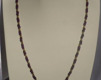Purple and Gold Beaded Necklace with Brass Flower Charm
